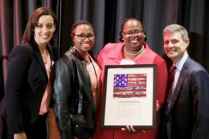 Partnership Award Honoree Monica Jackson with her daughter Marteka, Supervising Attorney Rachel Rintelmann, and Executive Director Eric Angel