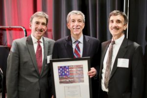 Servant of Justice Honoree Tom Papson with his twin brothers, Ron and Don