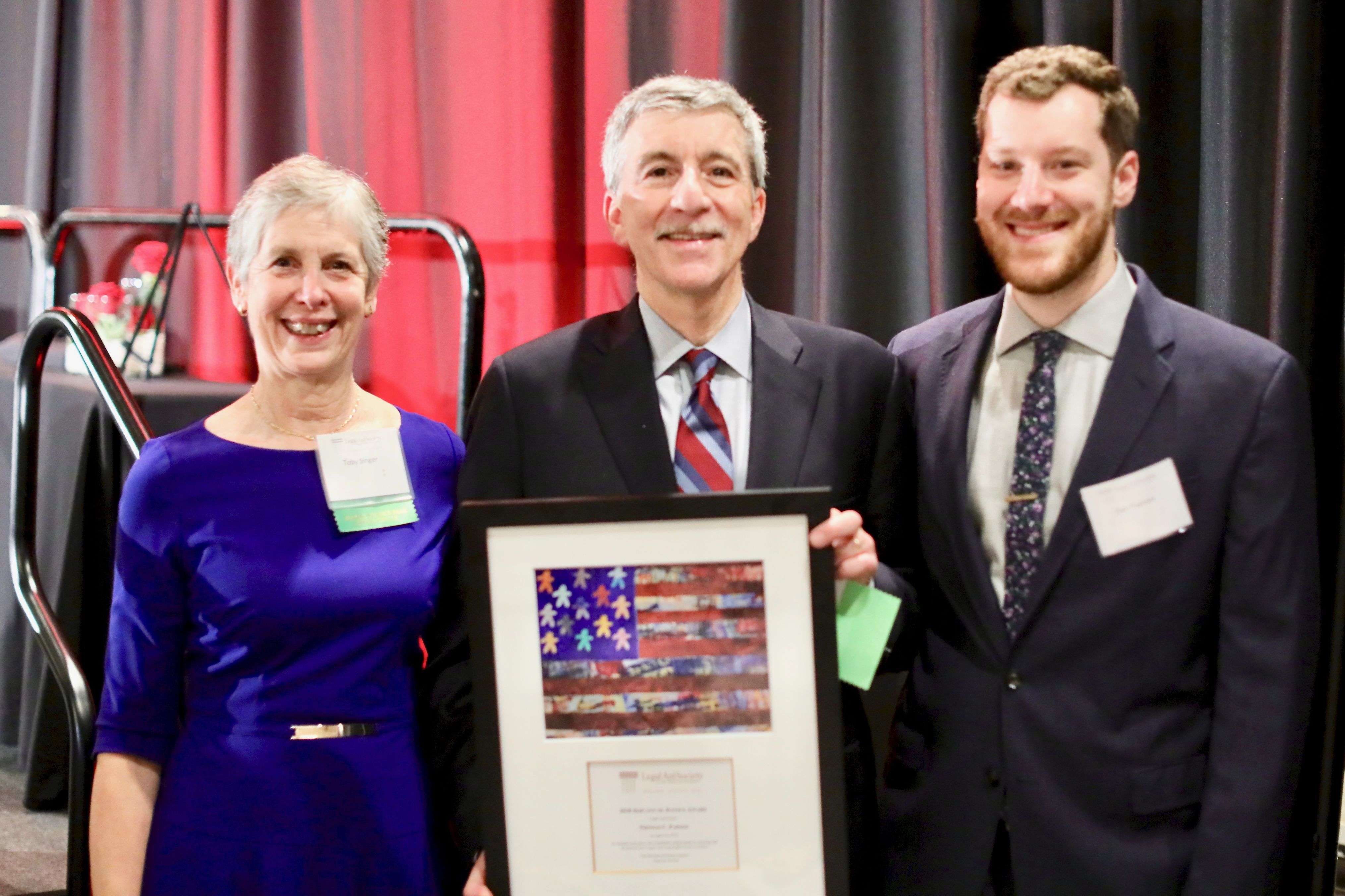 Servant of Justice Honoree Tom Papson with his wife Toby Singer and son Daniel