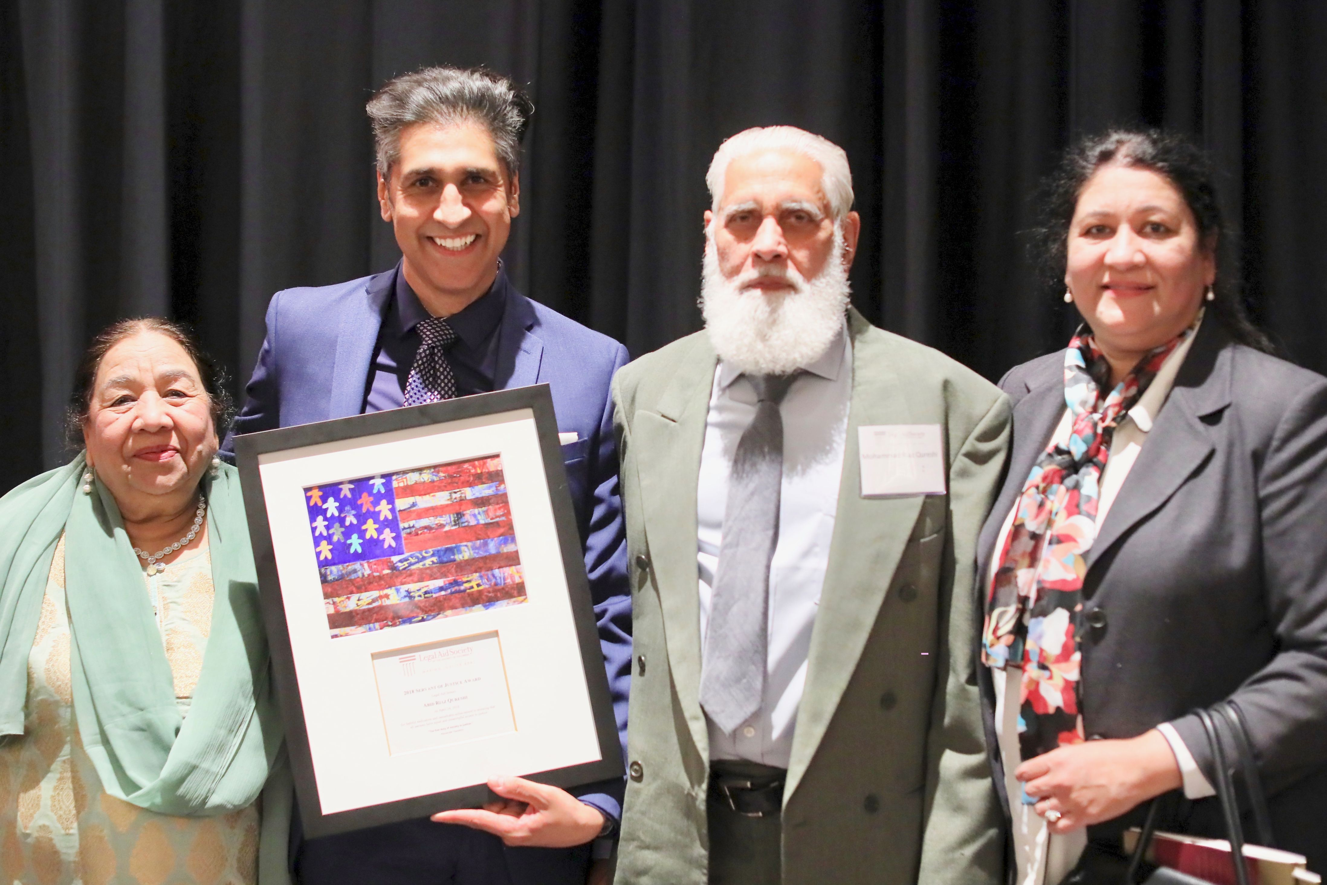 Servant of Justice Honoree Abid Riaz Qureshi with his parents and sister