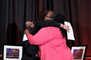 Photo of Supervising Attorney Rachel Rintelmann embracing Partnership Award Honoree Monica Jackson