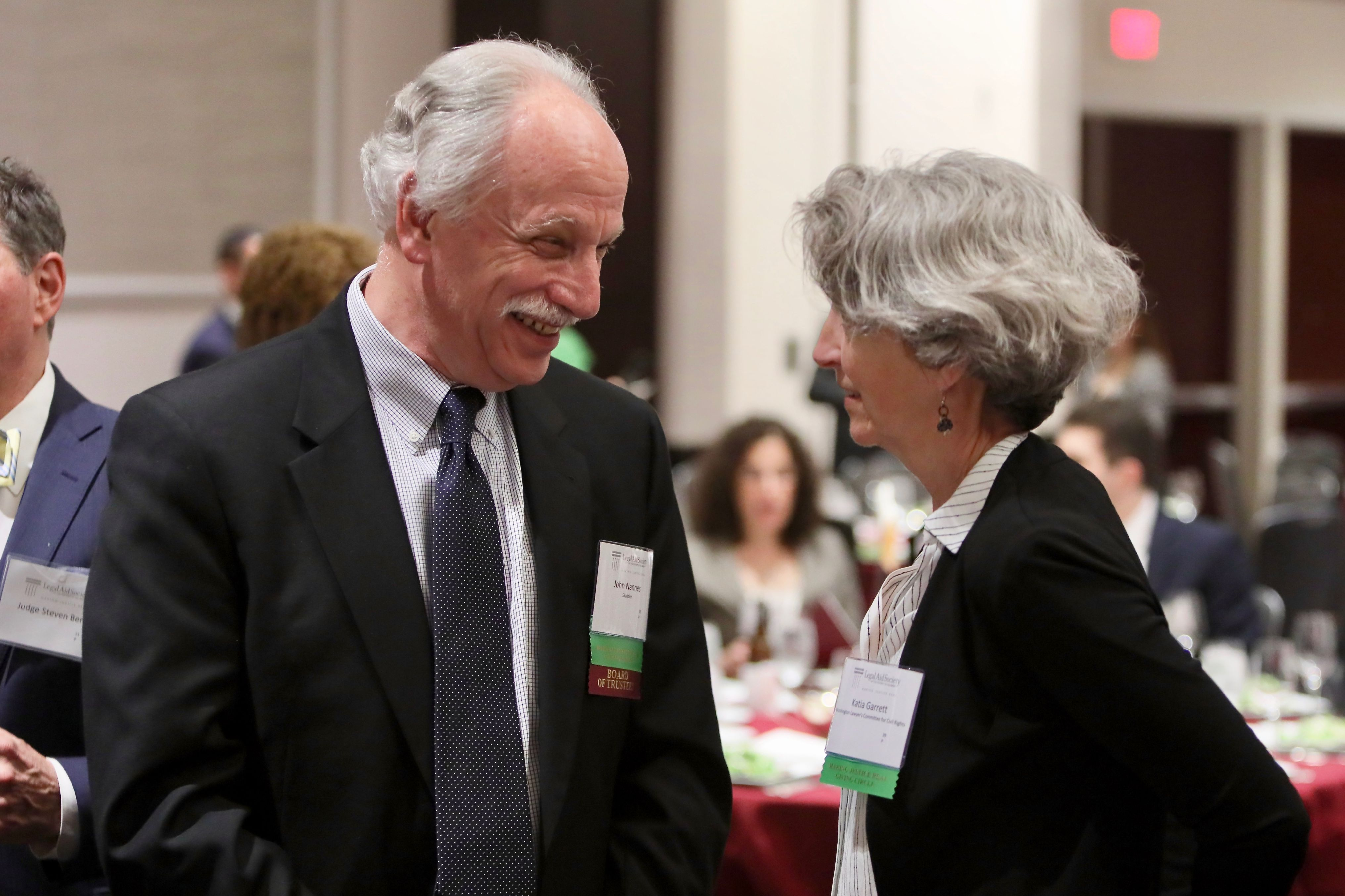 Photo of Board member John Nannes of Skadden, Arps, Slate, Meagher & Flom LLP with Katia Garrett of the Washington Lawyers' Committee for Civil Rights and Urban Affairs