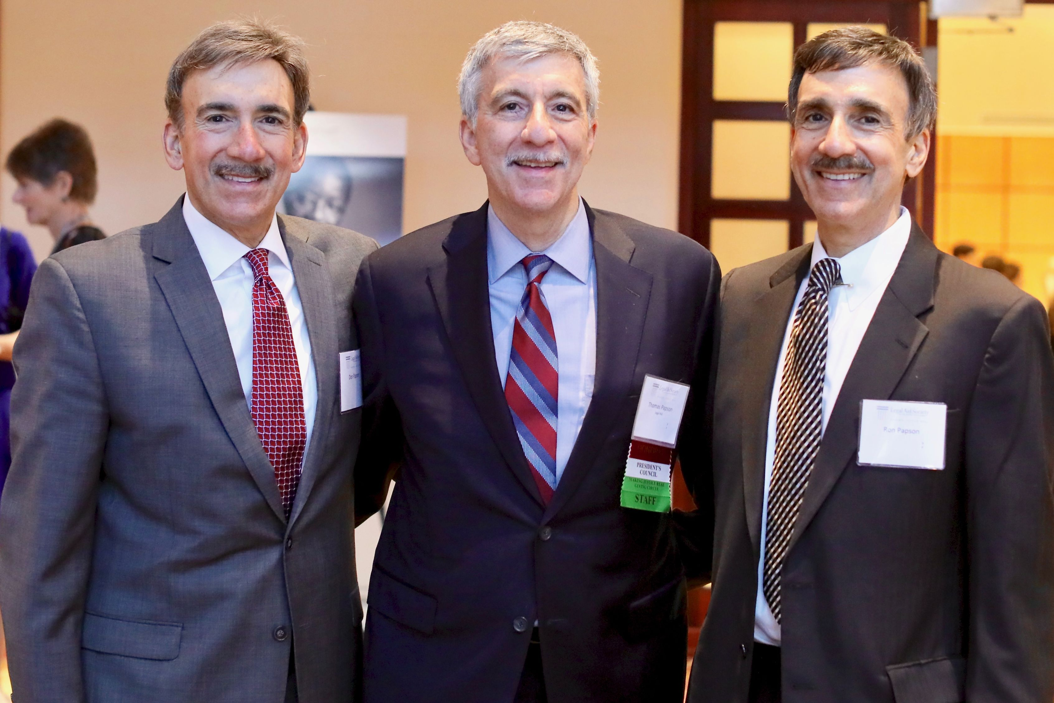 Servant of Justice Honoree Tom Papson with his twin brothers, Don and Ron