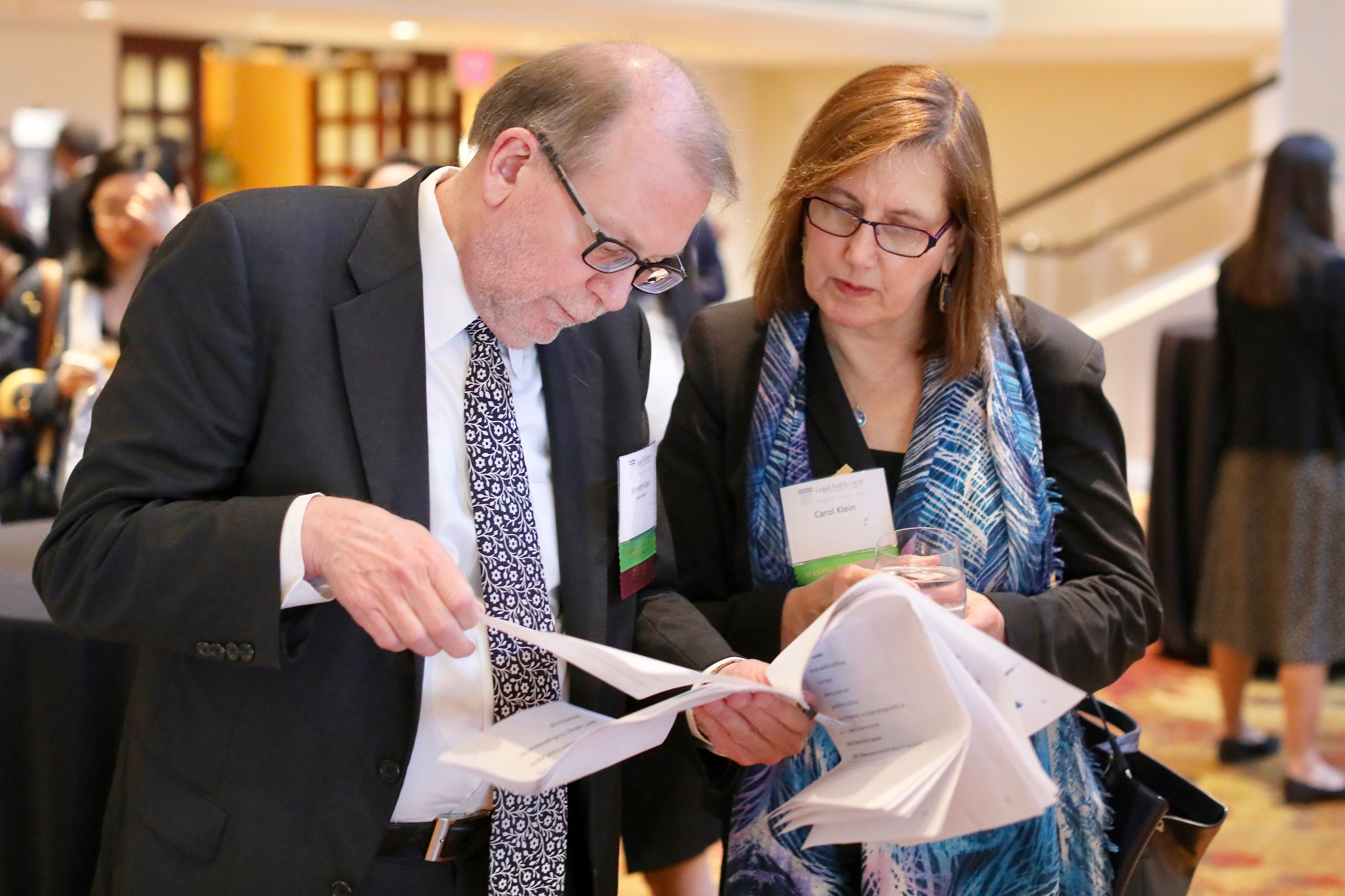 Board President Ken Klein of Mayer Brown goes over his script one last time with his wife, Carol Doran Klein of USCIB