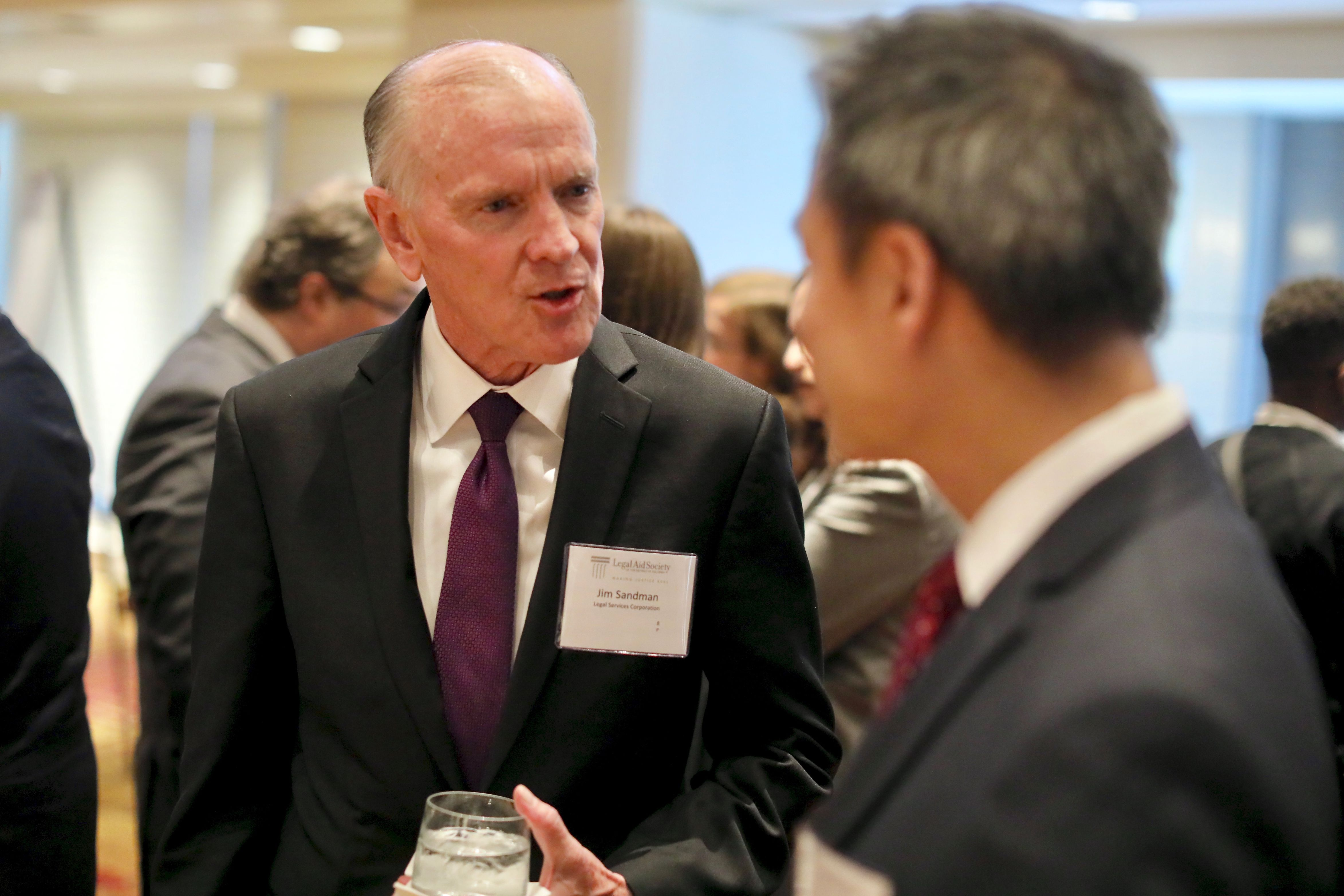 Jim Sandman, President of the Legal Services Corporation, with Legal Director Chinh Le